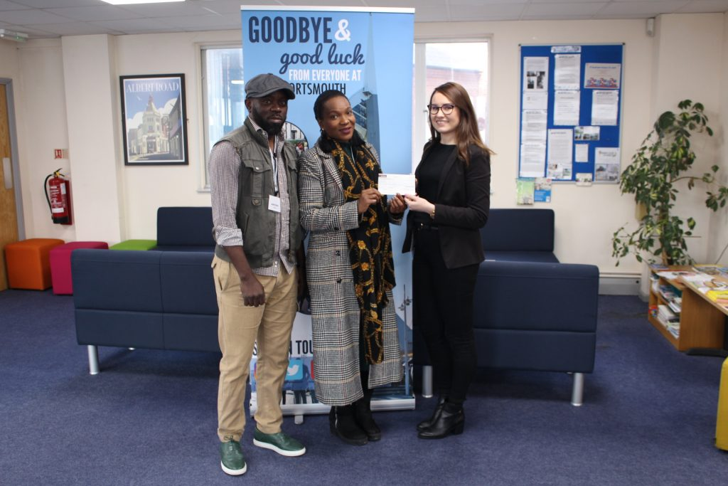 LSI Portsmouth hand over charity cheque to URBOND
